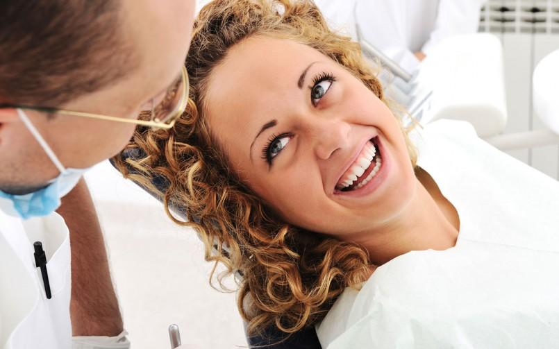 patient smiling after treatment dental clinic dubai
