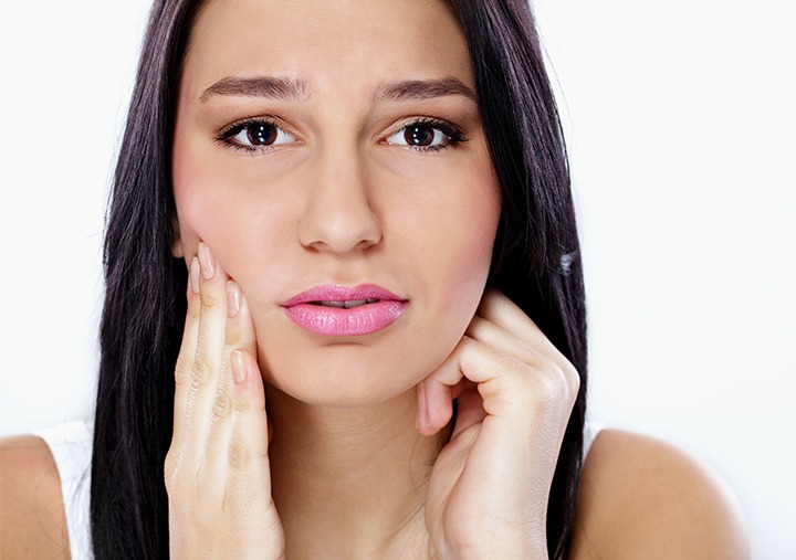 cover image lady with tooth ache