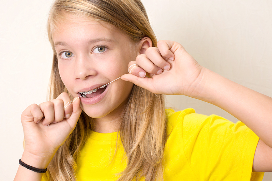 how to use super floss with braces