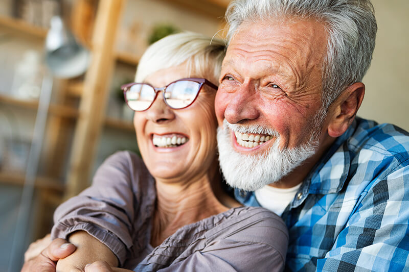 couple-smiling-after-dental-implant