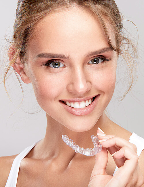 girl-smiling-with-invisalign